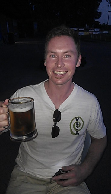 Bruce Marshall celebrates his hundred with a refreshing ale.